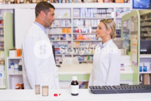 Pharmacists talking each other