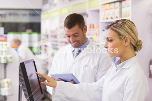 Team of pharmacists using computer