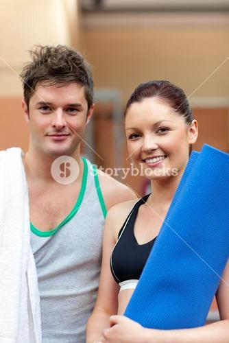 Portrait of a happy couple after fitness exercises smiling to the camera