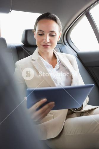 Pretty businesswoman using her tablet pc
