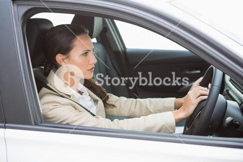 Businesswoman honking the horn