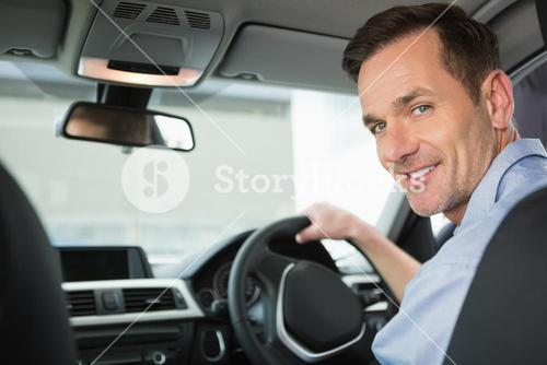 Smiling woman in the drivers seat