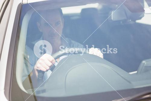 Focused man sitting at the wheel