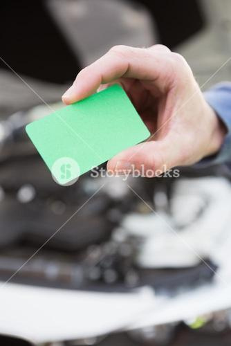 Close up of man holding card