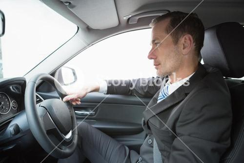 Handsome businessman in the drivers seat