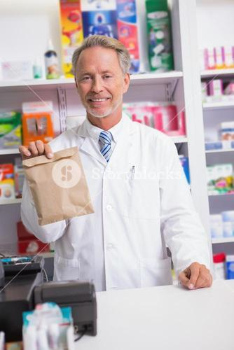 Senior pharmacist showing a envelope