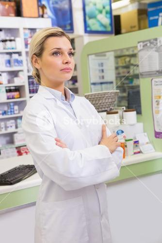 Junior pharmacist with arms crossed