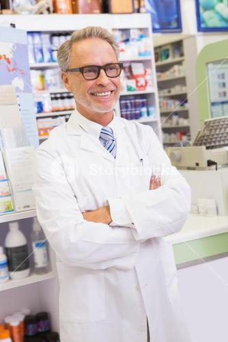Senior pharmacist with arms crossed