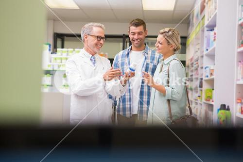 Pharmacist and customers talking about medication