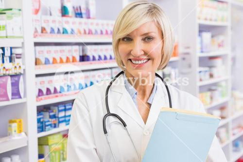 Smiling doctor with stethoscope holding files