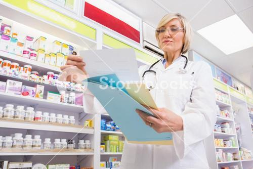 Concentrated doctor reading a prescription