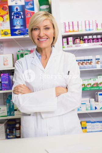 Smiling pharmacist with arms crossed