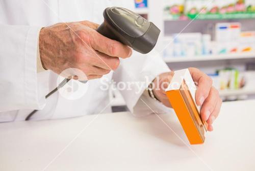 Pharmacist scanning medication with a scanner
