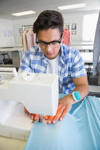 Concentrated university student sewing