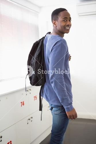 Smiling university student with backpack