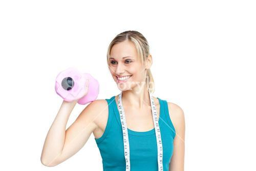 Smiling young woman holding dumbbells