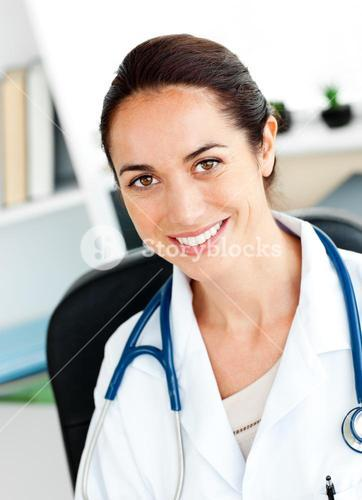 Selfassured female doctor smiling at the camera