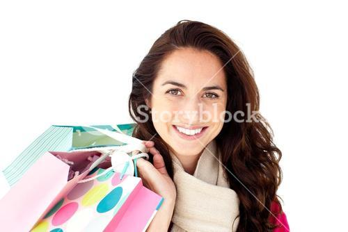 Radiant woman wearing a scarf and holding shopping bags