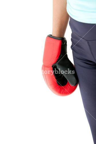 Close up of the fist of a woman wearing boxing gloves