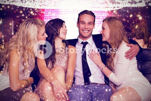Composite image of girls flirting with young man