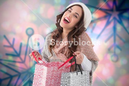 Composite image of happy brunette opening shopping bag