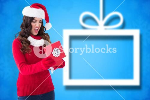 Composite image of disappointed brunette opening christmas gift