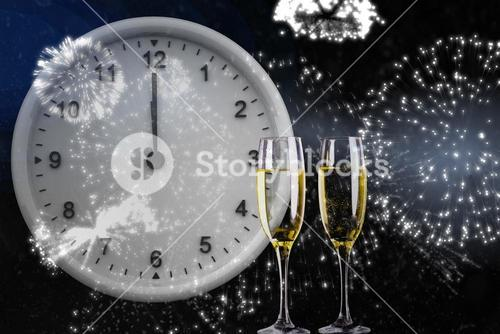 Composite image of clock at midnight