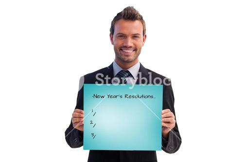 Composite image of smiling businessman holding a white card