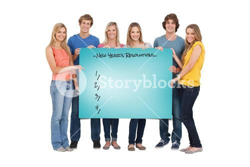 Composite image of a group of people holding blank sheet