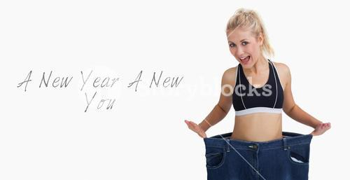Thin woman wearing old pants after losing weight