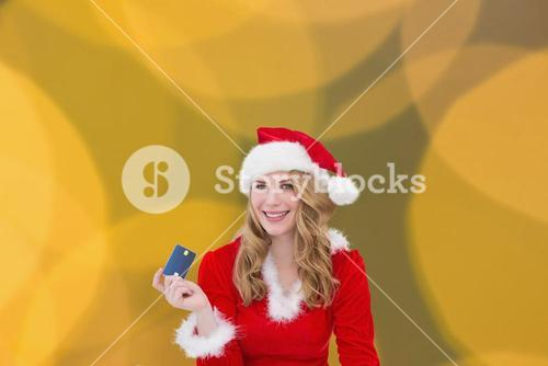 Composite image of woman with a credit card