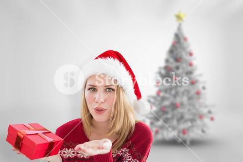 Composite image of woman blowing a kiss