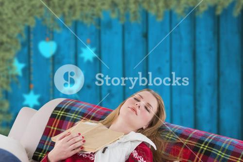 Composite image of woman asleep on couch
