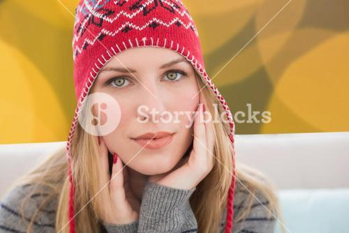 Composite image of woman wearing hat