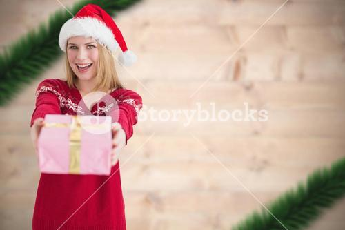 Composite image of smiling woman with present