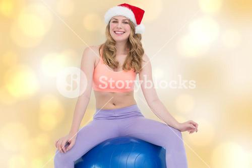 Composite image of smiling blonde woman sitting on exercise ball