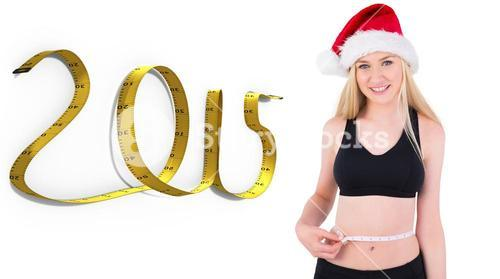 Composite image of fit festive young blonde measuring her waist