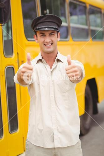 Smiling bus driver looking at camera