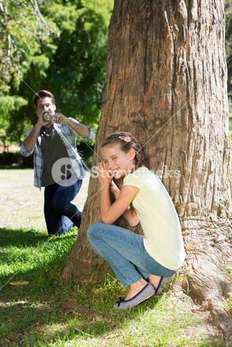 Father and daughter playing in the park