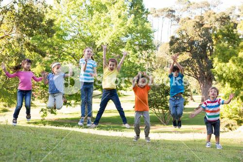 Children jumping in the park