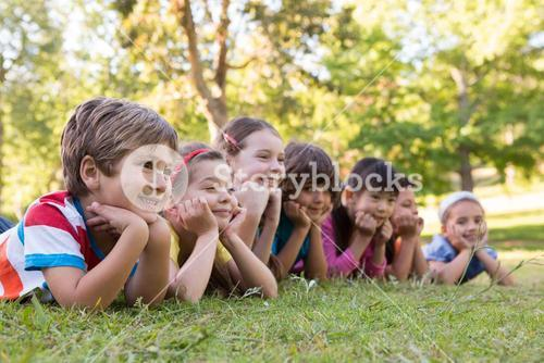 Little children smiling in a row
