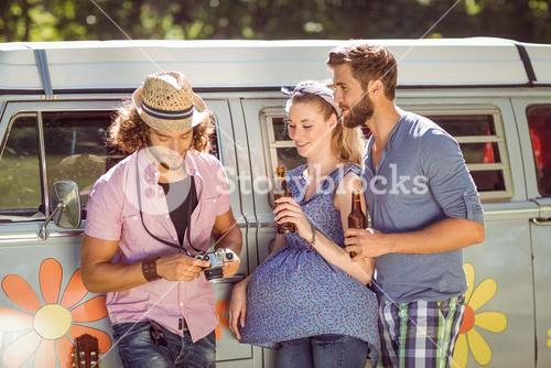 Hipster friends chatting and drinking