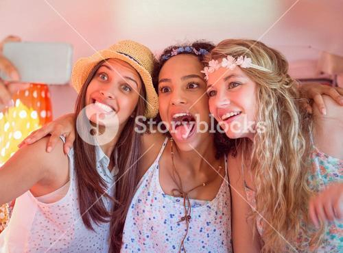 Hipster friends on road trip taking selfie
