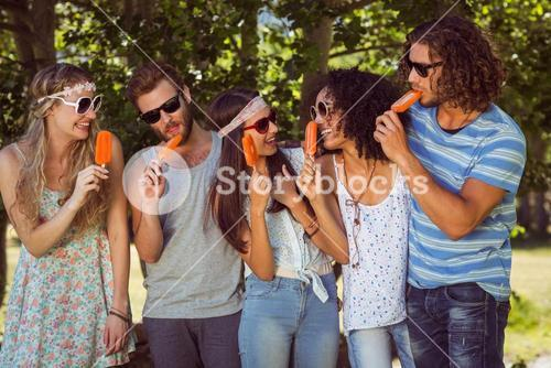 Hipster friends enjoying ice lollies