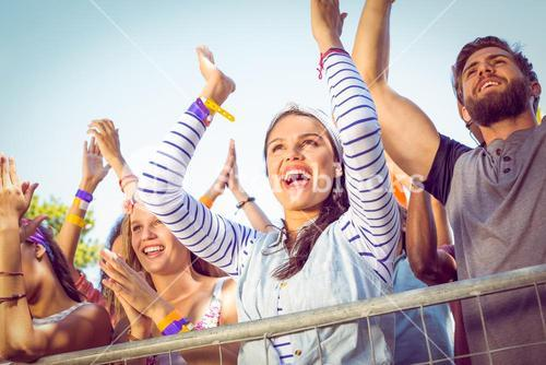 Excited music fans up the front