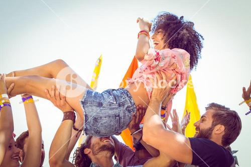 Happy hipster woman crowd surfing