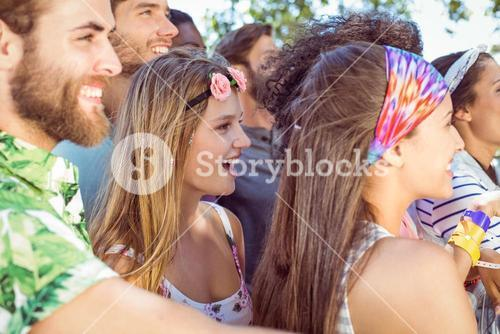 Happy hipsters listening to live music