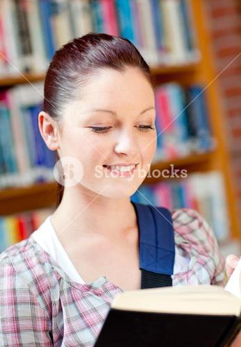 Positive Young woman reading a book