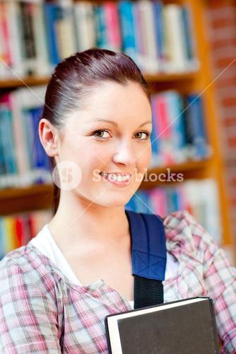 Joyful Young woman holding a book