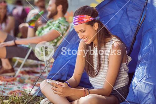 Carefree hipster sending text message